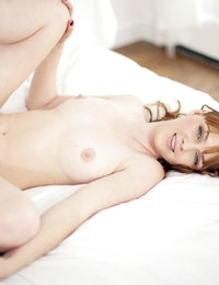 Curvaceous redhead Marie McCray lies back to fully absorb the pleasure of her lovers cock pumping her moist shaved pussy