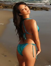 Sexy Asian Alluring Vixen babe Hoshi shows off her perfect body at the beach in a shiny blue string bikini