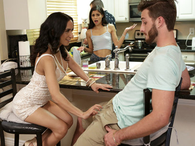 Katya Rodriguez and her dad are preparing a dinner so her parents can meet her boyfriend Lucas Frost. When Lucas knocks, Katya's stepmom Tia Cyrus answers the door. The second she lays eyes on Lucas, though, Tia knows she needs to have him. The moment Katya's back is turned, Tia drops to a crouch and whips out Lucas's cock so she can suck his big shaft. Putting her big knockers together for a titty fuck, Tia is in the process of working Lucas into a sexual frenzy when Katya spots them.It takes some fast talking, but Tia convinces Katya to join them instead of ratting her out. Soon Katya is happily sucking away at Lucas's cock as her stepmom rubs her tits. When Tia settles on the bar stool with her skirt hiked up, Katya leans forward to feast on her stepmom's pussy. Meanwhile, Lucas slides into her from behind to deliver a proper pussy pounding. Not to leave Tia out, Lucas steps up to fuck her landing strip snatch as well while Katya makes sure to muffle her stepmom's moans.Moving to the floor, Lucas lays down so he can play stud to both lovely ladies. Katya slides back down to give him a full-on stiffie ride in her bald pussy, while Tia sits on his face so he can feast on her creamy fuck hole. Then the girls switch it up to ensure that they're each fully satisfied. Only then do they each get on their knees so that they can take turns sucking and stroking Lucas's hardon until he delivers a facial to each of them.