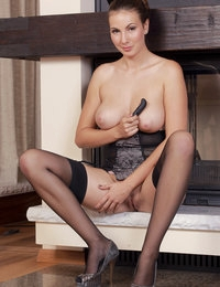 Connie shows off her round breasts and gorgeous pussy