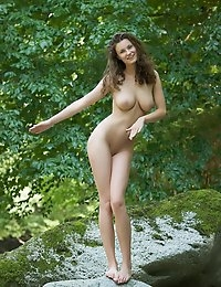 "This week's Best of Femjoy features the sensual, sexy, seductive Susann in ""Let It Shine"". And she certainly does that. The truth is, she is always shining which is why felt it appropriate to give her the title of Best of Femjoy this week. In this photo set, photographer Stefan Soell takes her into the woods and let's her shine in nature. Simple, focused, beautiful - just like Susann herself.Here's what many of her adoring fans had to say about this latest set from one of the Best of Femjoy;""An absolute work of art!""""Susann's lovely mass of wavy hair and her delightful naked bottom. I could gaze forever at the wonderful soft curving contours and smooth shape of Susann's lovely buttocks. It is such a privilege to see the stunningly beautiful bottom of such a very pretty girl. Thanks, Susann. You are gorgeous.""""This is a truly beautiful and elegant image. Susann is statuesque with her lovely slim figure, her beautiful long legs and her delightful shapely buttocks. Thanks, Susann, for this delightful pose. Your bottom is very pretty and so sweet.""""i could honestly say that even shakespeare himself would be at a loss of words to describe susann's beauty. She and bianca beauchamp are easily the two hottest women one the web. And props to stefan [you] are an awesome photographer and one lucky person to be able to work with susann.""""Total perfection, always!""!"" Many thanks, Susann and Master Soell!""""Wow! Always most remarkable, our dear Susann!!""""A marvel, indeed!!!! Hypergorgeous perfection!!""""Shining brightly!!! Five stars, always!!""""OMG, what a beautiful rear view of Susann! """"Susann is stunning as always.""""She is Still the most beautiful woman on this sight.""Well said members. We feel the same way and we are so glad to hear that you do too. Susann is indeed a special gal and we are so glad to be able to bring that special beauty to you. If you haven't already, take the time to check out Susann's latest set - and all her other sets with Femjoy - you'll thank us later. :) Enjoy!"