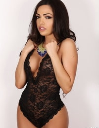 Busty Alluring Vixen Karla shows off her round perfect ass in a sexy little black lace outfit