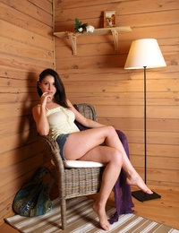 Alluring Jasmin in blue undies gives strip session in wicker chair
