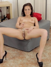 Hot brunette teases her pussy with sex toys