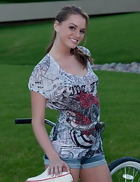 Beautiful Devine Ones babe Tori Black flashes her perky tits outdoors in public photo #1