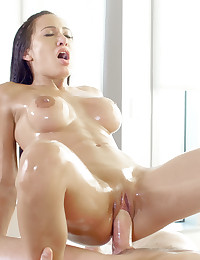 Girl gets a massage and shows her appreciation with an oily hand job and sensual fuck. photo #1