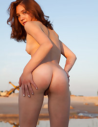 Stripping in the sand photo #12