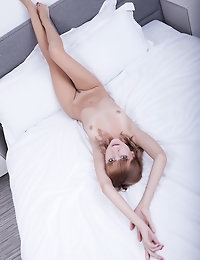 Teen angel on white bed photo #1